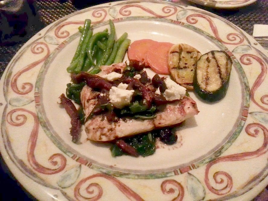Pollo Campagnola on a decorative plate served with veggies.