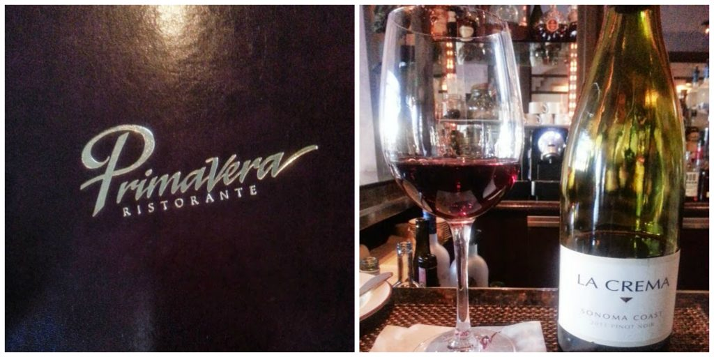 A picture of the Primavera menu next to a glass of wine.