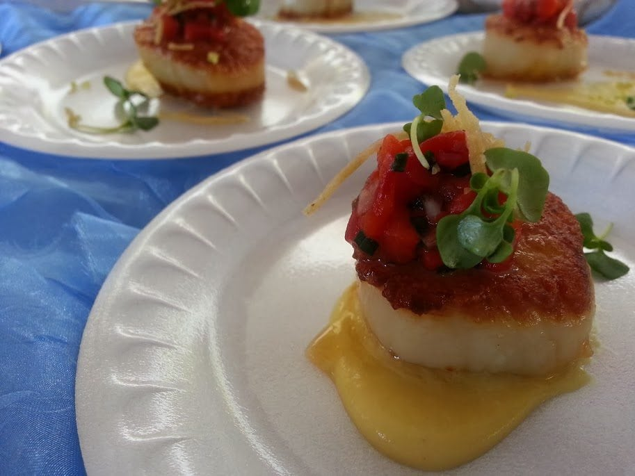 Pan seared Boston Diver scallops with a cauliflower saffron puree topped with a roasted red pepper relish from Oceanaire