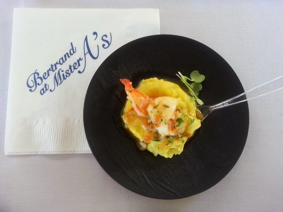 Shrimp Provencale with braised fennel mousseline and a touch of pernod on a black plate