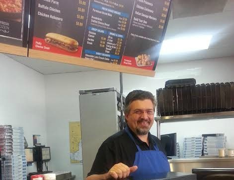 Shane Casey working at Domino's Pizza