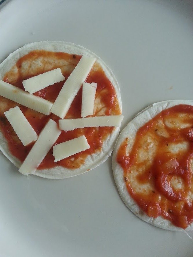 Cheese on Spider Pizzas
