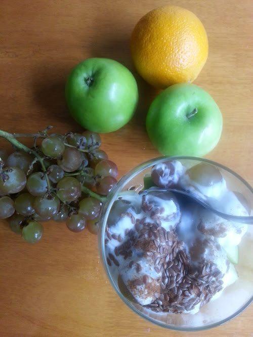 fruit salad - grapes, apples and an orange