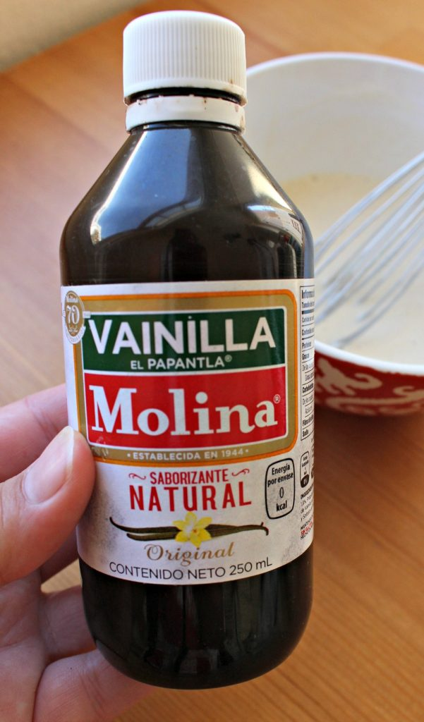 Hand holding bottle of Mexican Vanilla