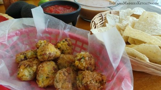 Fried Mac n Cheese Balls next to salsa and chips