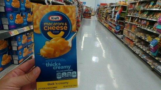 Holding a box of Kraft Mac n Cheese at a grocery store