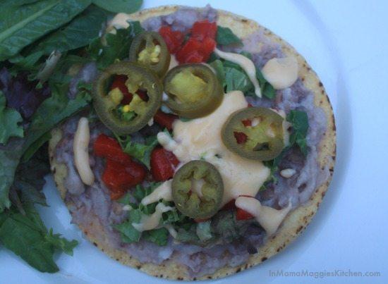 Bean and Nacho Cheese Tostada with jalapeños