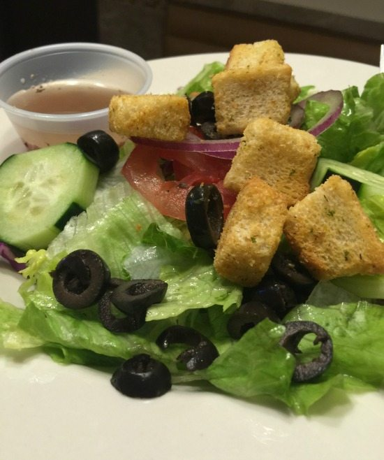 Italian Salad with dressing and croutons at Casanova Brothers