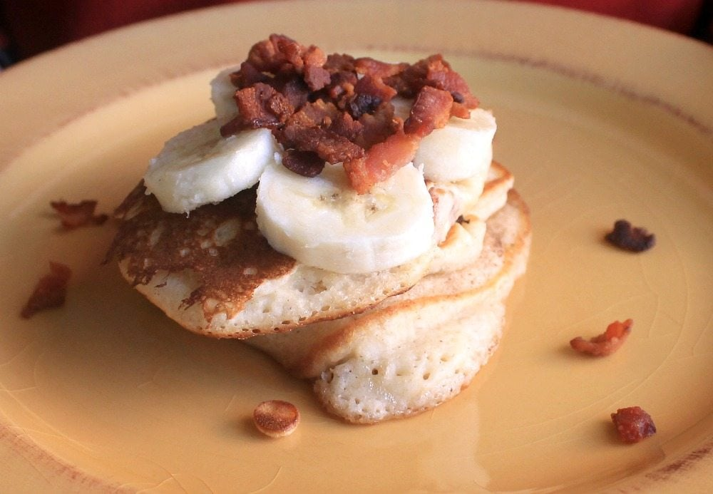 Banana Bacon Pancakes is a mix of savory and sweet. This fluffy breakfast will make you swoon. Enjoy! by Mama Maggie's Kitchen