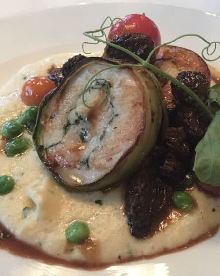 Halibut over polenta in a morel sauce
