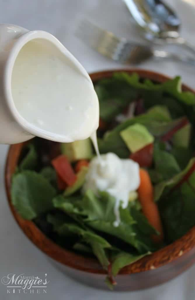 Lemon Parmesan Dressing - creamy and lemony. So good that you'll put it on your salad and everything else on your plate. :) Mama Maggie's Kitchen