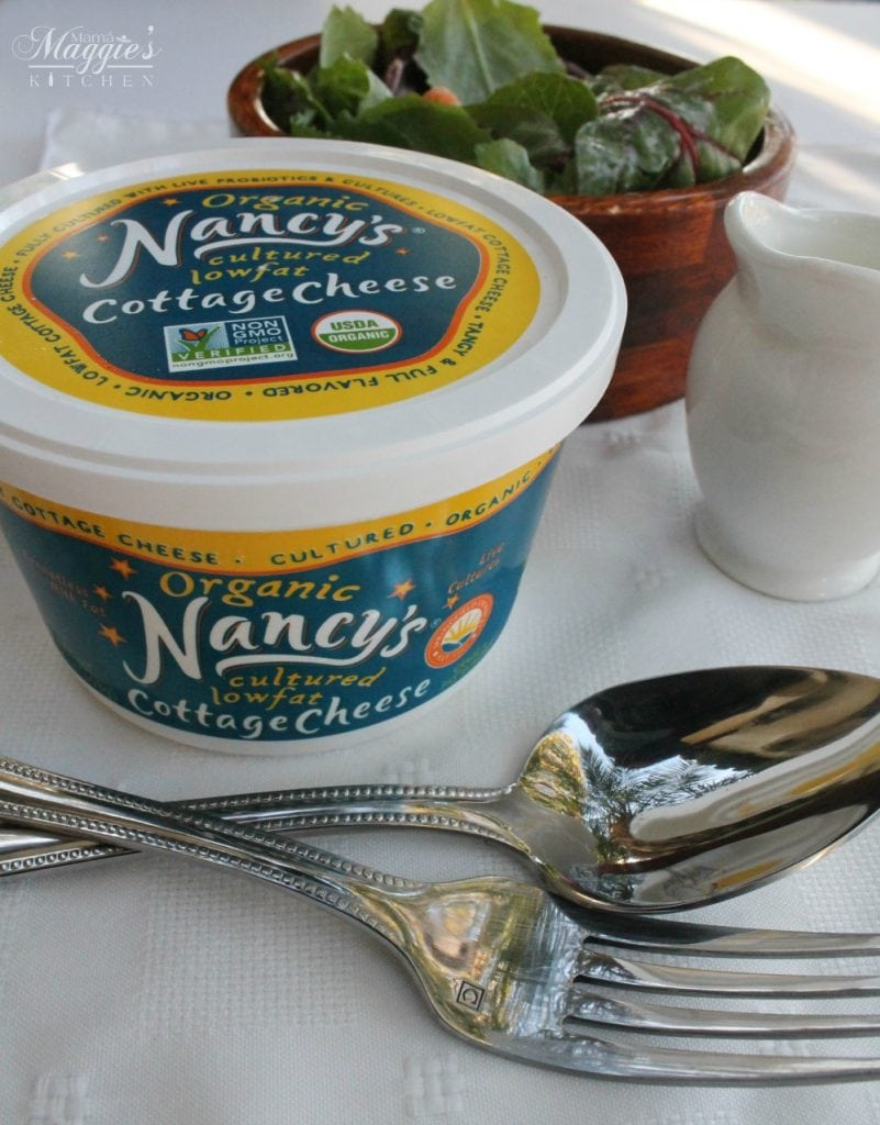 Organic Nancy's Cottage Cheese next to a bowl of salad and cutlery