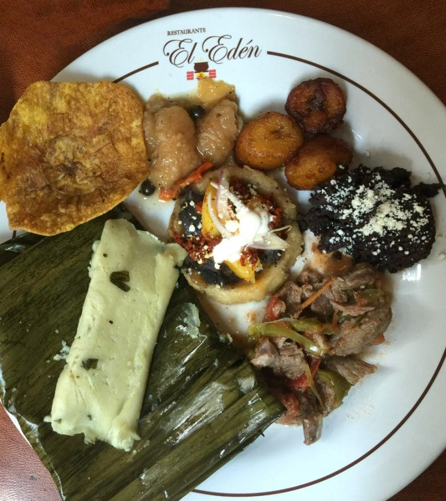 Plate at El Eden, served with platanos fritos, frijoles, sope and tamales