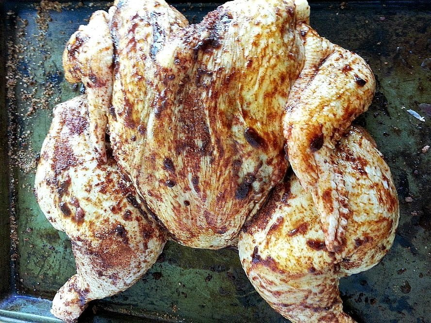 Whole Chicken Rubbed and ready to be cooked.