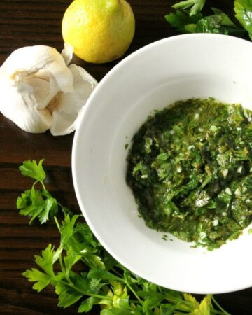 Chimichurri Sauce is an uncooked, herb garlic sauce that is used on grilled meat. Serve it at your next BBQ. Everyone will love it! By Mama Maggie's Kitchen