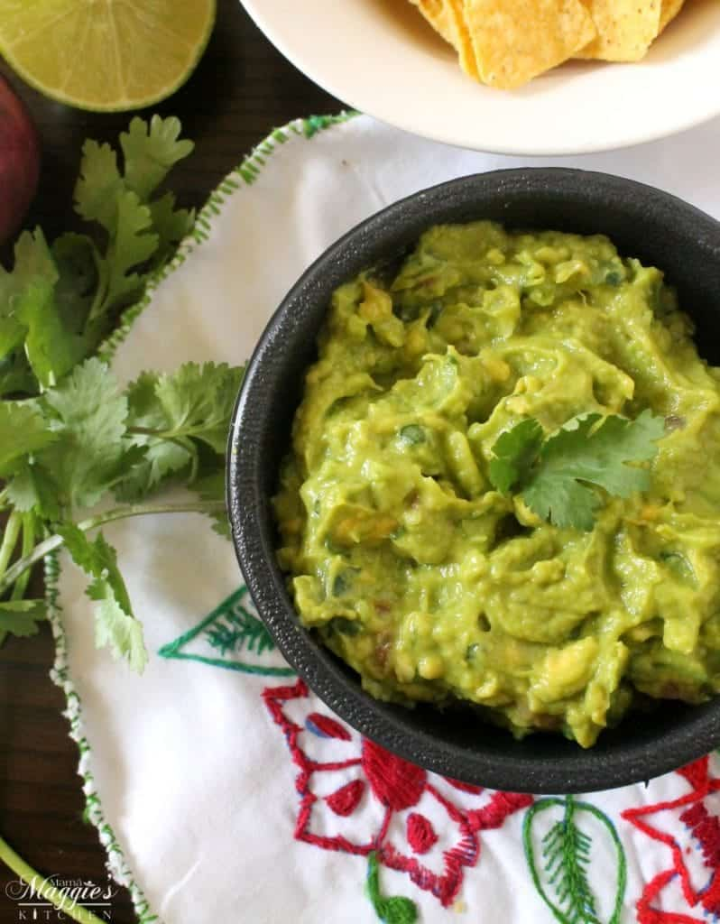 It's not a party unless there's a bowl of Creamy Guacamole and bag of chips on the table. Always a crowd pleaser, always yummy. By Mama Maggie's Kitchen