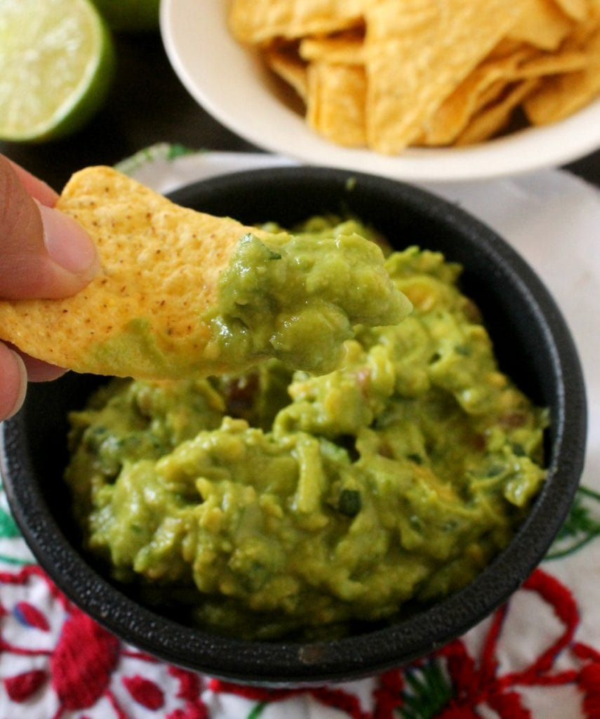 It's not a party unless there's a Creamy Guacamole and bag of chips on the table. Always a crowd pleaser, always yummy. By Mama Maggie's Kitchen