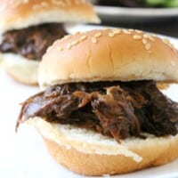 Slow Cooker BBQ Beef Sliders are miniature, itty bitty bites of goodness. Only 5 ingredients and minimal work will get you, your family, and your guests fed. Enjoy! By Mama Maggie's Kitchen
