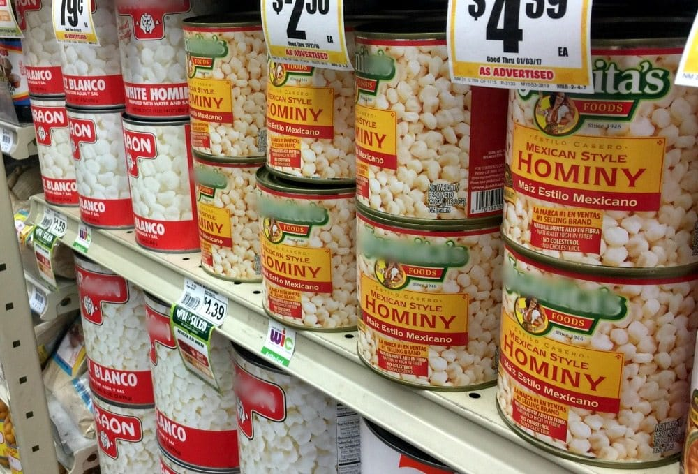 Cans of hominy at the grocery store.