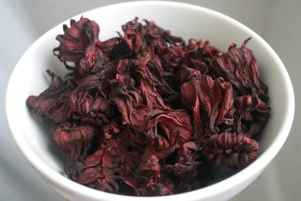A bowl of dried hibiscus flowers.