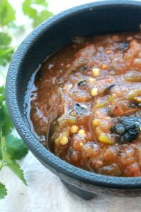 Roasted Tomato Salsa is a spicy and delicious topping for any of your Mexican food favorites. by Mama Maggie's Kitchen