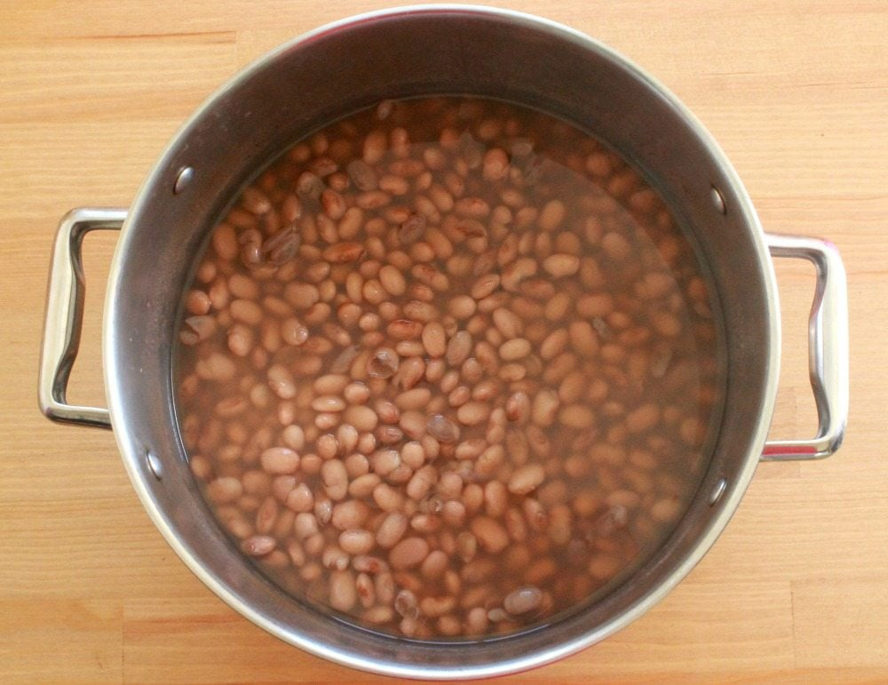 Cooked pinto beans in a large stock pot.