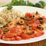 Pescado a la Veracruzana, or Veracruz-Style Fish, is a savory dish that will blow your tastebuds away. It's not very spicy with delicious bites of olive and briny capers. Enjoy! By Mama Maggie's Kitchen