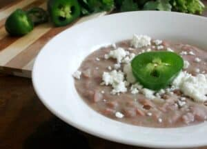 Refried Beans, or Frijoles Refritos, are delicious as a side dish or top with cheese for an yummy appetizer. This Mexican food classic is possibly the easiest dish to recreate at home. By Mama Maggie's Kitchen