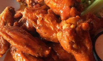 Spicy Buffalo Chicken Wings are incredibly fast and easy-to-make. They make a tasty appetizer that everyone will love. By Mama Maggie's Kitchen