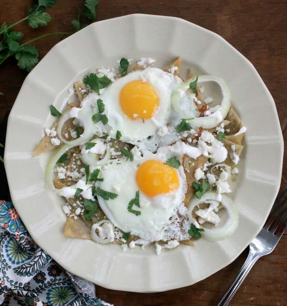 Chilaquiles with Fried Eggs, or Chilaquiles con Huevos Fritos, is a delicious and flavorful breakfast dish that's a favorite in Mexico. by Mama Maggie's Kitchen
