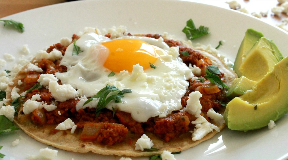 Chorizo and Egg Tostada is delicious and flavorful breakfast option. This yummy Mexican food classic is the best way to start your day. By Mama Maggie's Kitchen