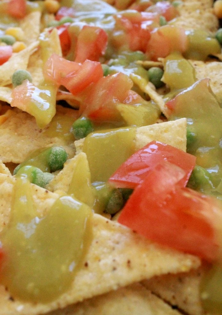 Baked Vegetarian Nachos make the best weeknight meal. This dish comes together fast and uses up leftovers. By Mama Maggie's Kitchen