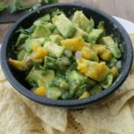 Avocado Mango Salsa is a yummy appetizer or the perfect topping for your next chicken or fish dinner. By Mama Maggie's Kitchen
