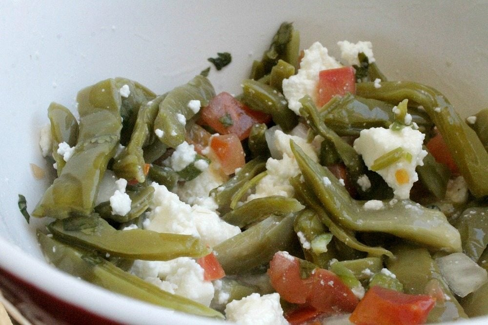 Cactus Salad with Queso Fresco, or Ensalada de Nopales con Queso Fresco, is a traditional Mexican food recipe. It's simple, delicious, and good-for-you too. By Mama Maggie's Kitchen