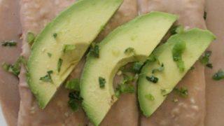 Enfrijoladas de Queso (or Cheese Filled Tortillas dipped in Bean Sauce)