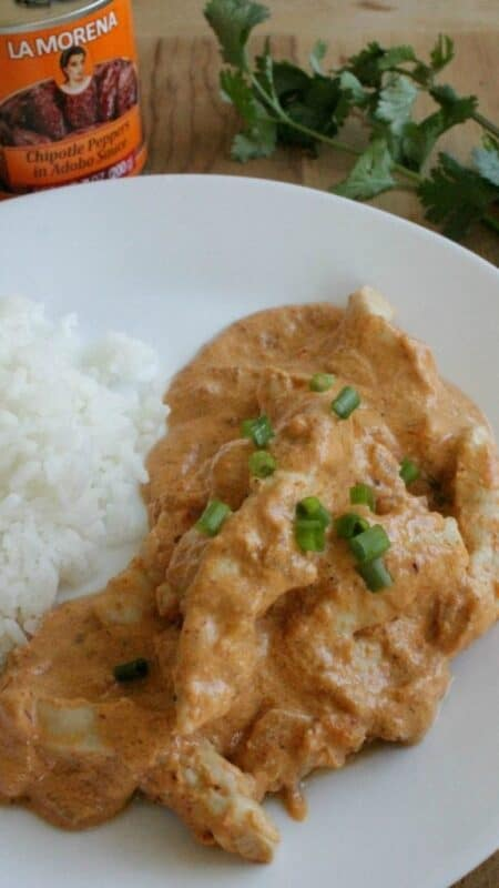 Jazz up dinner with this recipe! Chicken in Creamy Chipotle Sauce, or Pollo al Chipotle, is a rich and delicious dish that will make you want to lick the plate clean. By Mama Maggie's Kitchen