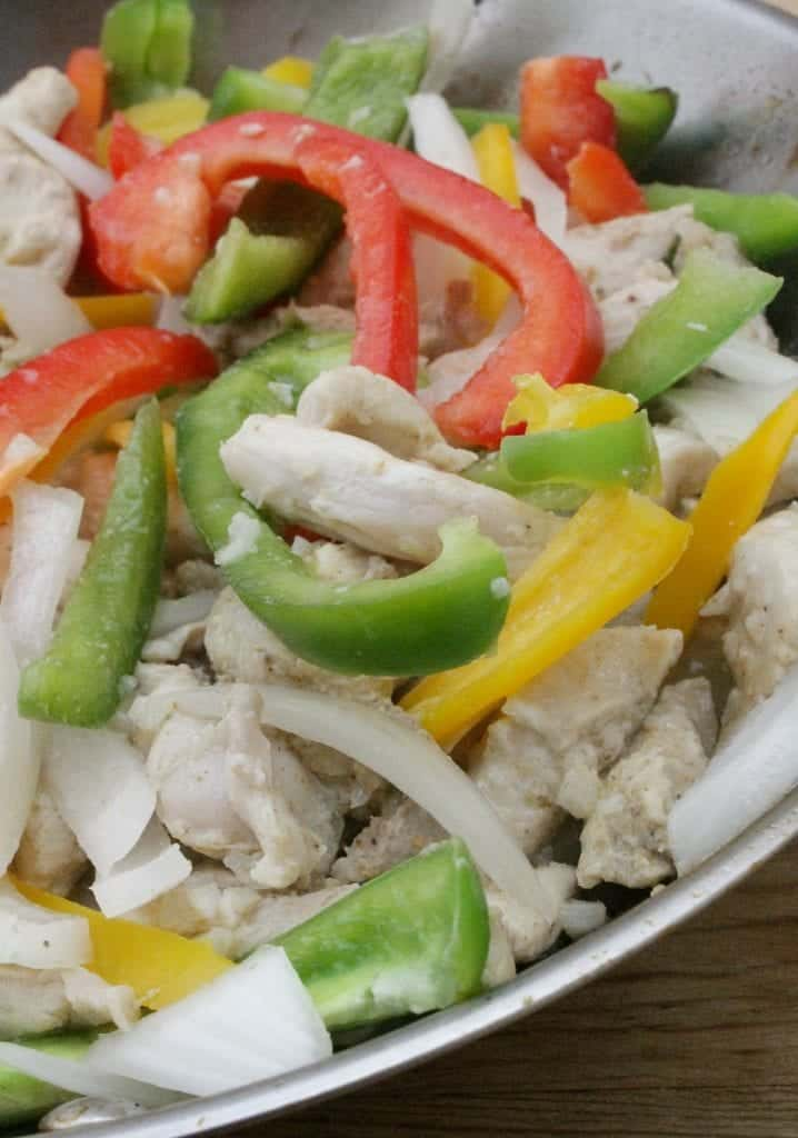 These Chicken Fajitas are a Tex-Mex classic. Flavorful and delicious. It's no wonder why we adopted them south of the border. By Mama Maggie's Kitchen