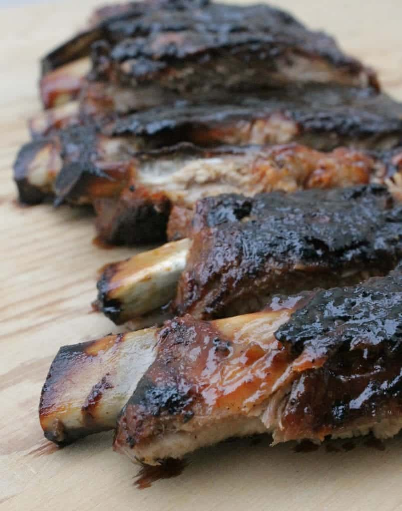 Grilled Ribs with Tamarind BBQ Sauce are full of bold, sweet, and spicy flavors. They scream summer fun by the grill. By Mama Maggie's Kitchen