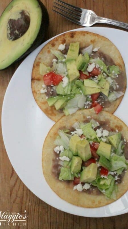 Bean Tostadas make for the ideal weeknight meal. Easy-to-make, cheap, and comes together quickly. By Mama Maggie's Kitchen