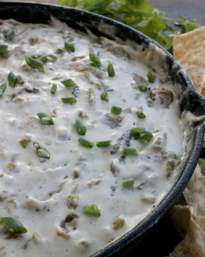 This warm Hatch Chile Cheese Dip will be the hit of any gathering. Perfect for your next Super Bowl party. By Mama Maggie's Kitchen