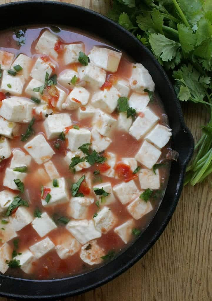 Queso Panela en Salsa Roja, or Panela Cheese in Mexican Red Salsa, is a delicious appetizer that also makes a great light meal. Creamy and not too spicy. By Mama Maggie's Kitchen