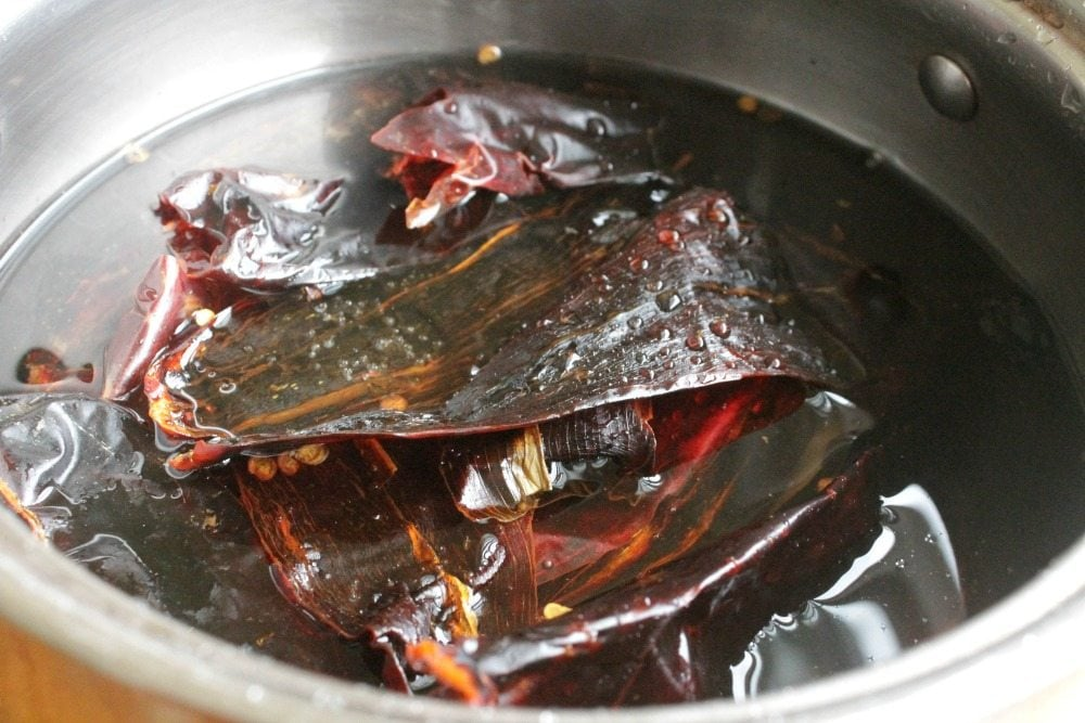 Reconstituting guajillo chiles in a pot