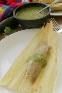 Chicken Salsa Verde Tamales is a classic Mexican favorite. Made traditionally during the Holidays or for special occasions and served with yummy salsa. By Mama Maggie's Kitchen