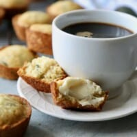 Zucchini Lemon Jalapeño Muffins served next to a cup of coffee.