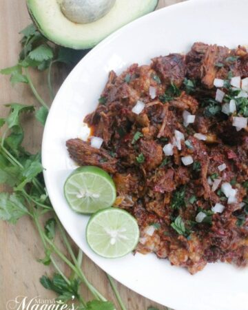 Barbacoa de Res tastes out of this world. With strong, bold flavors and meat that has been cooking for hours. Serve with tortillas, onions, avocado, and lime. Enjoy! By Mama Maggie's Kitchen