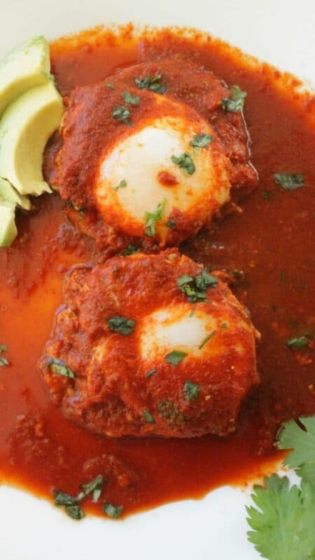 Drowned Eggs in Guajillo Sauce, or Huevos Ahogados en Chile Guajillo, is a classic Mexican recipe. Delicious and savory. Perfect for breakfast, lunch, or dinner. By Mama Maggie's Kitchen