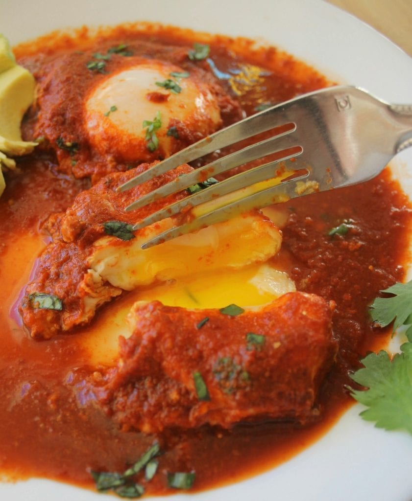 Drowned Eggs in Guajillo Sauce (Huevos Ahogados en Salsa de Chile Guajillo) is a classic Mexican recipe. Delicious and savory. Perfect for breakfast, lunch, or dinner. By Mama Maggie's Kitchen