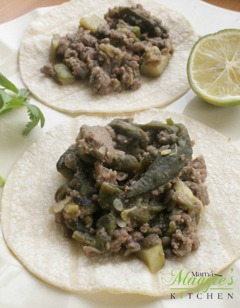 You won't miss the meat with these Lentil and Poblano Chile Tacos (Tacos de Lentejas con Rajas de Chile Poblano). So yummy, so delicious, and 100% vegan. Top with salsa, and serve with refried beans. Hope you enjoy! By Mama Maggie's Kitchen