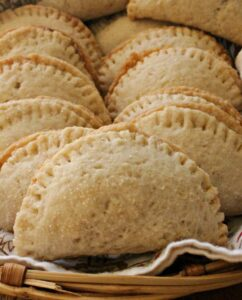 Stacked Pineapple Empanadas, or Empanadas de Pina, in a basket