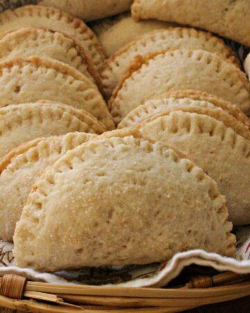 Stacked Pineapple Empanadas, or Empanadas de Pina, in a basket